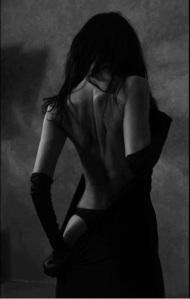 escort ibiza unzipping black evening dress