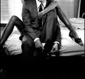 ibiza escort long legs client in suit