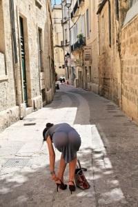 ibiza esxcort fasteninh her shoe in street sheer dress
