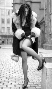 marbella escort stockings and fur coat in street