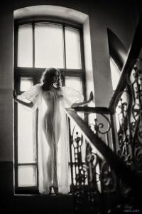 escort marbella backlit on staircase
