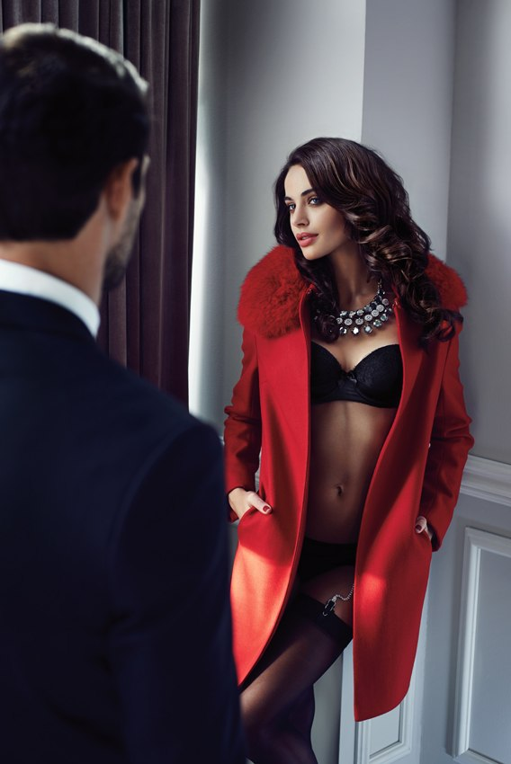 girl in lingerie and coat at hotel door