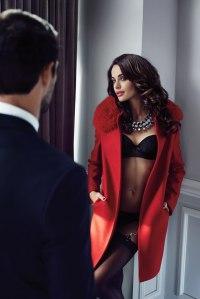 ibiza escort girl in lingerie and coat at hotel door