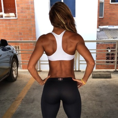 fit escort girl in black yoga pants and white crop top